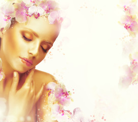 Relaxation. Exquisite Woman with Flowers. Floral Background