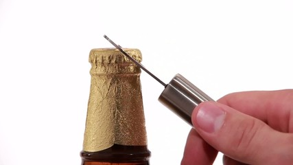 opening golden beer bottles