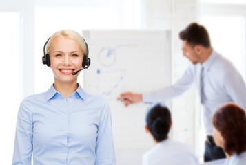 friendly female helpline operator with headphones