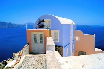 Colorful house overlooking the sea at Santorini, Greece