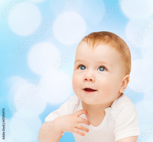 canvas print picture smiling baby lying on floor and looking up