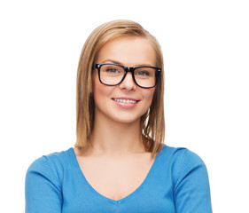 smiling woman in eyeglasses