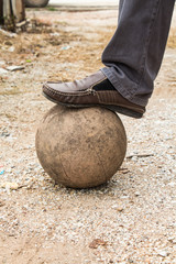 Old ball with his feet