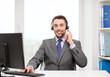 helpline operator with headphones and computer