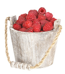 Fresh raspberry in the wooden bucket