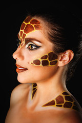 Girl with make-up giraffe