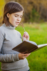 Portrait of girl with book