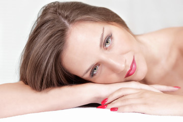 Beautiful woman relaxed pose, rests head on hands