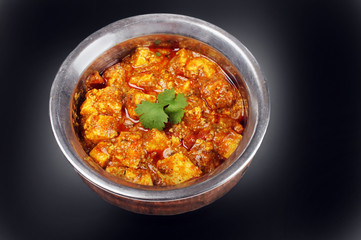 Paneer Masala: classic Indian dish in vintage bowl