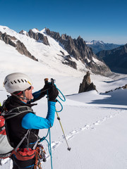 Mountaineer taking picture with a camera in the mountains.