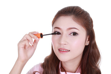 woman face with mascara brush