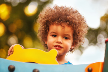 Afro American boy on playground in kindergarten