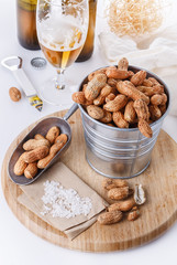 Roasted peanuts on a bowl over white background