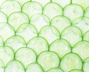 Cucumber and slices on  background.