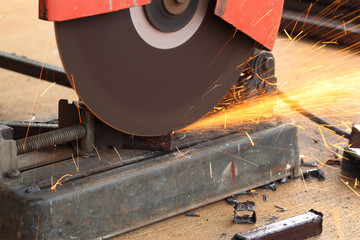 Worker cutting steel rod