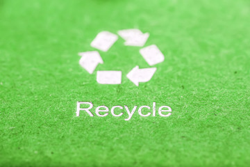 recycle symbol on green cardboard