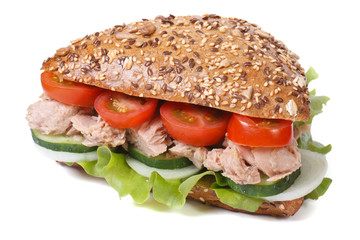 sandwich with tuna and vegetables isolated on a white