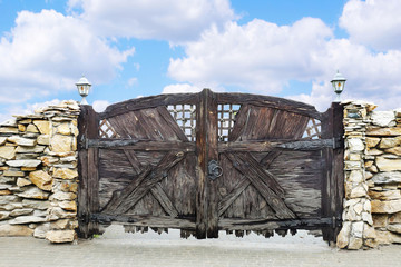 Decorative gate made ​​of rough planks