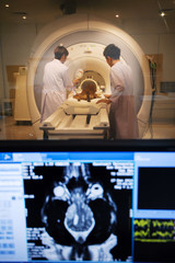 veterinarian doctor working in MRI room with moniter foreground