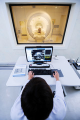 veterinarian doctor working in MRI computer control room