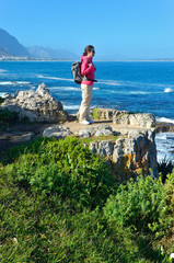 Woman looking at ocean view in Hermanus, South Africa