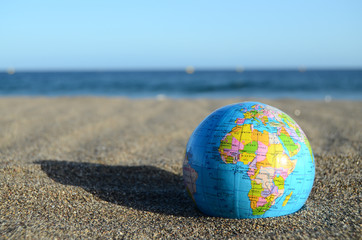 Globe Earth on the Beach