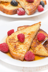 delicious French toast with raspberry and maple syrup, vertical