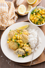 fish cakes with mango salsa and white rice, top view, vertical