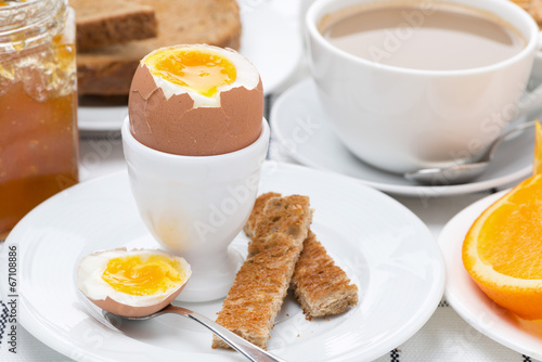 canvas print picture fresh breakfast with eggs, toast and coffee with milk, close-up
