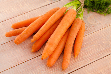 Fresh organic carrots with their tops