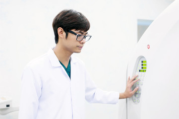 veterinarian doctor working in CT scanner room
