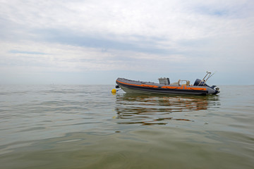 Motorboat floating at sea in summer
