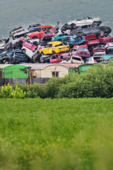 Pile of used cars in junkyard