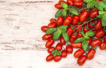 cherry tomatoes and basil leaves. food background