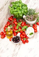 fresh basil, tomatoes, mozzarella and olive oil. food background
