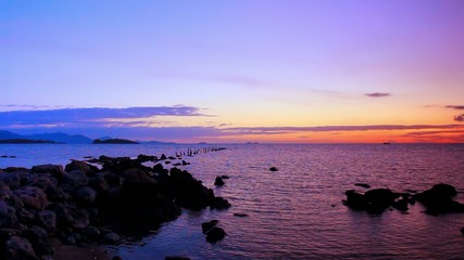 The rocky shore of Andaman Sea at sunset. Koh Samui, Thailand.