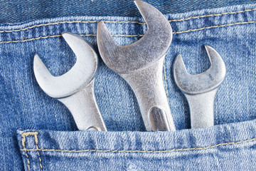 set of wrenches in jeans pocket