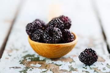 black raspberries in wooden spoon