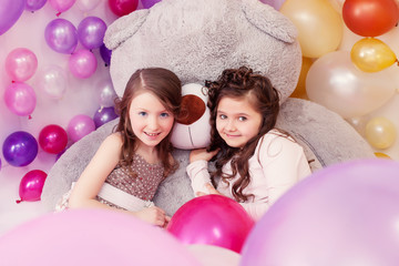 Lovely girlfriends posing with big teddy bear