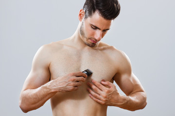 Man shaving his chest