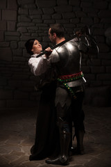 Medieval knight and lady posing