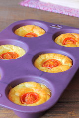 Mini savory cakes with cheese and tomatoes
