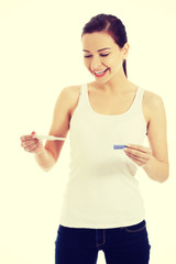 Happy woman with pregnancy test.