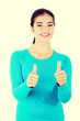 Teen woman gesturing thumbs up