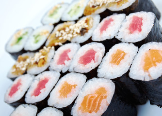 Roll made salmon, eel, tuna, vegetables