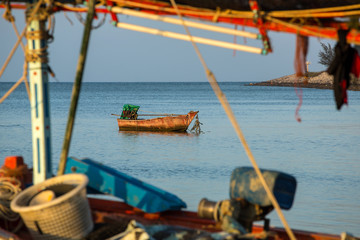 Wooden fishing boat in the sea in Thailand