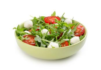 salad from arugula tomatoes and mozzarella
