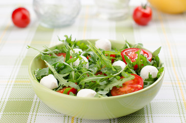 salad from arugula tomatoes and mozzarella