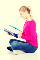 Young student woman with workbook.