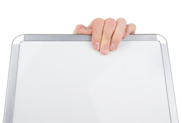 Hand holding an empty whiteboard (magnetic board) isolated